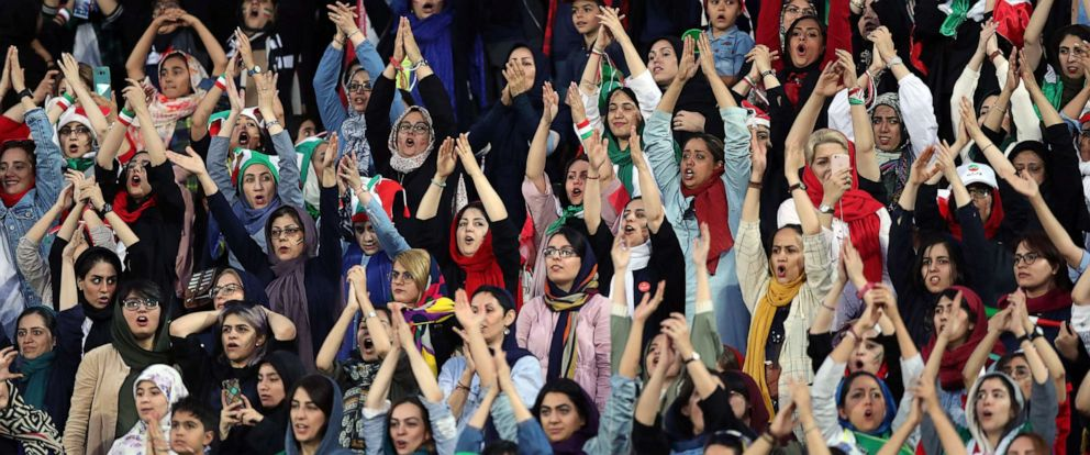 PHOTO: Women Iranian fans cheer during the FIFA World Cup Qualifier match between Iran and Cambodia at Azadi Stadium, Oct. 10, 2019 in Tehran, Iran.