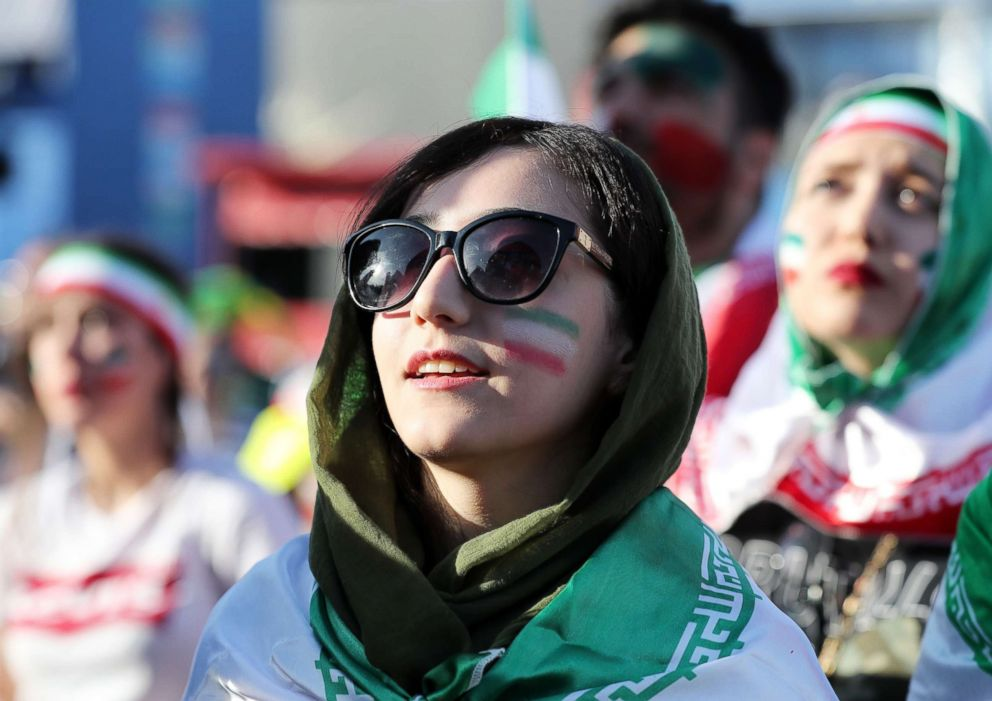 PHOTO: Fans of Iran watch the FIFA World Cup 2018 group B preliminary round soccer match between Morocco and Iran at the FIFA fan zone in Moscow, Russia, June 15, 2018.  Banned from stadiums at home, Iranian women attend World Cup soccer matches in Russia iran world cup fan 02 ap jef 180620 hpEmbed 17x12 992