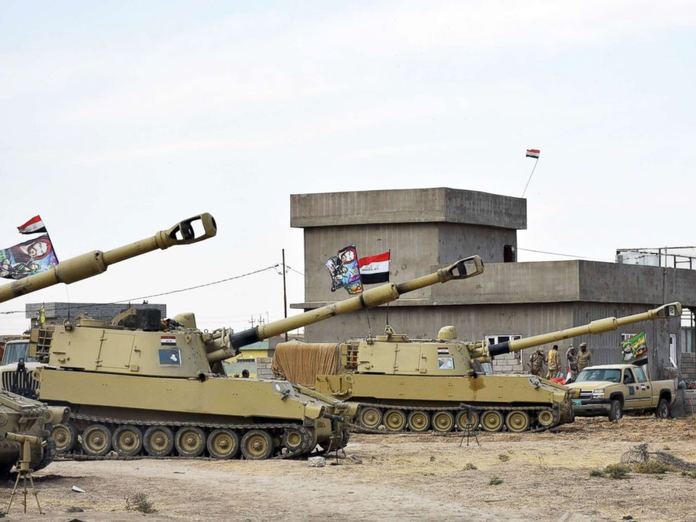 PHOTO: Iraqi army vehicles are seen parked near a former Kurdish military position on Oct. 13, 2017, in the northern Iraqi town of Tuz Khurmatu, near Kirkuk.