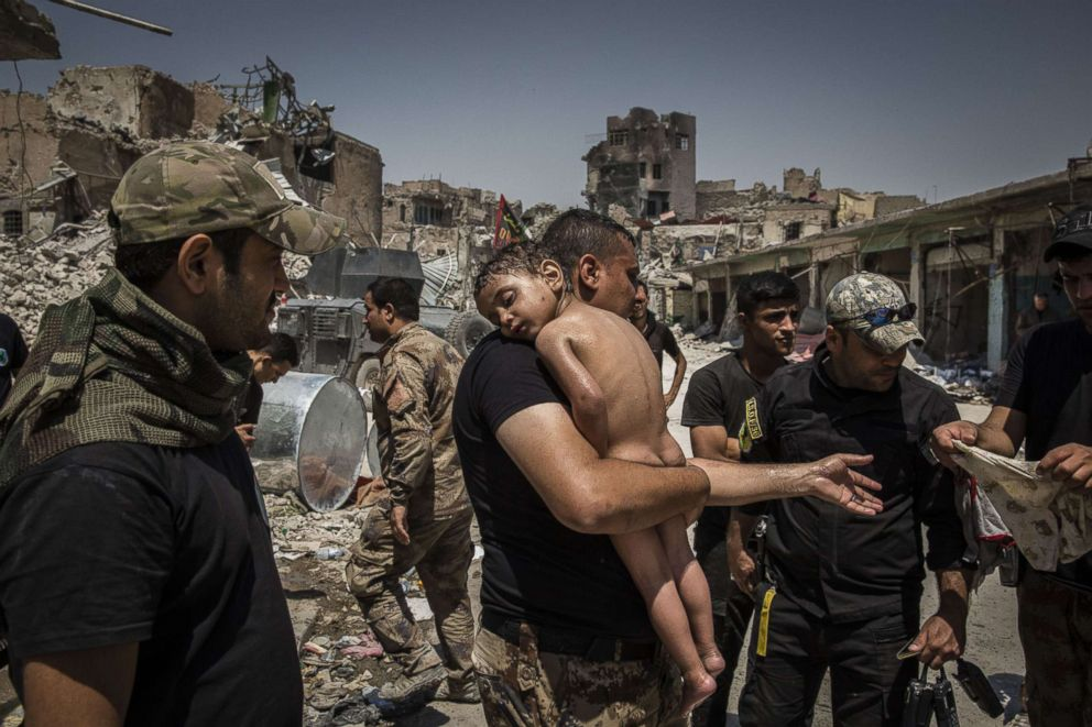 PHOTO: An unidentified young boy, who was carried out of the last ISIS controlled area in the Old City by a man suspected of being a militant, that is cared for by Iraqi Special Forces soldiers in Mosul, Iraq, July 12, 2017.
