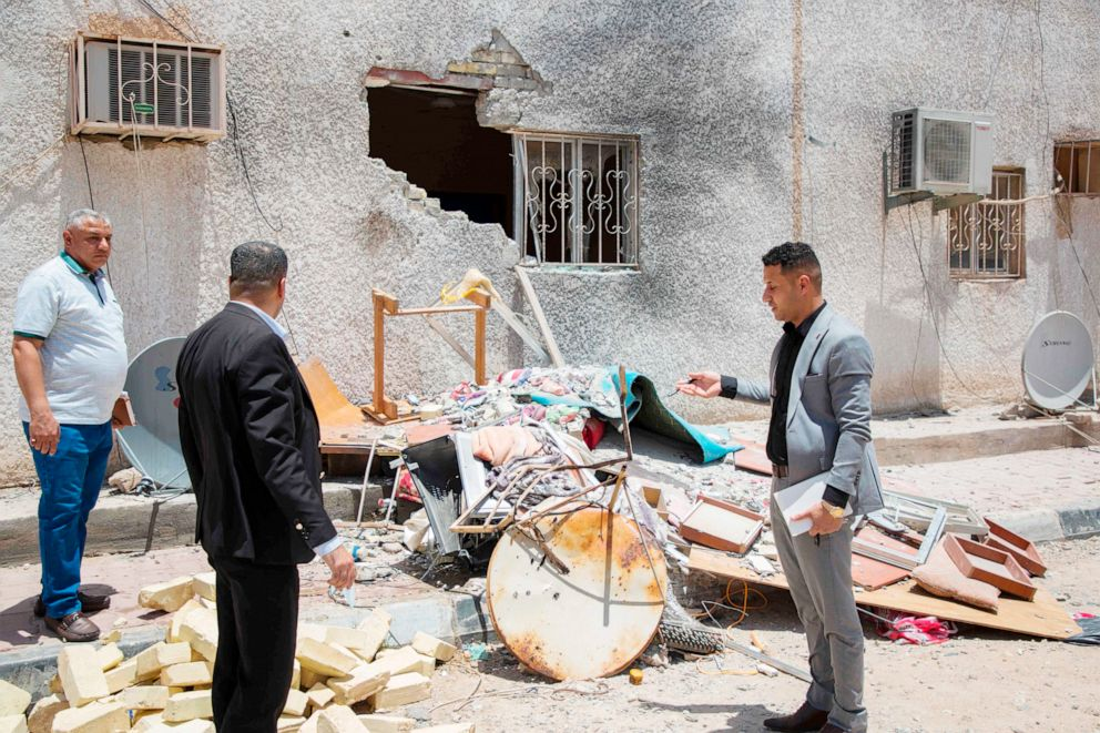 PHOTO:Iraqis inspect the damage at a drilling fascility that was hit by a Katyusha rocket in the Burjesiya area, a key oil-producing region hosting various Iraqi and foreign companies north of the Iraqi city of Basra on June 19, 2019.