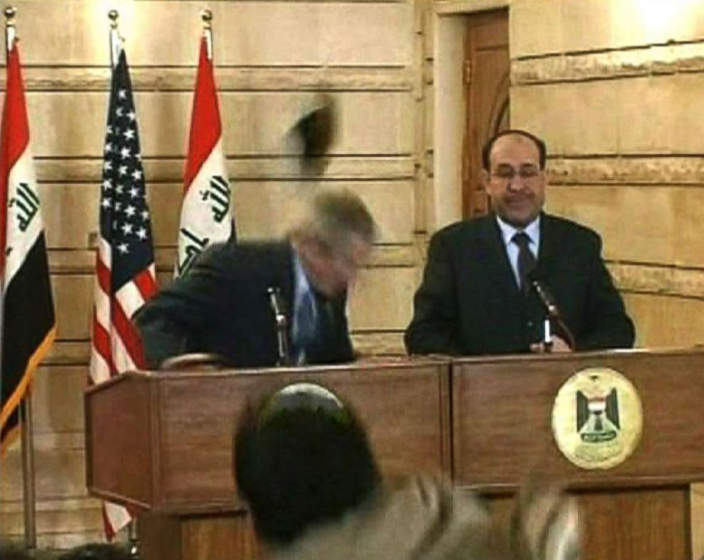 PHOTO: In this image from APTN video, Muntazar al-Zaidi, foreground, throws a shoe at President George W. Bush, who ducks, during a news conference with Iraq Prime Minister Nouri al-Maliki, Dec. 14, 2008, in Baghdad.