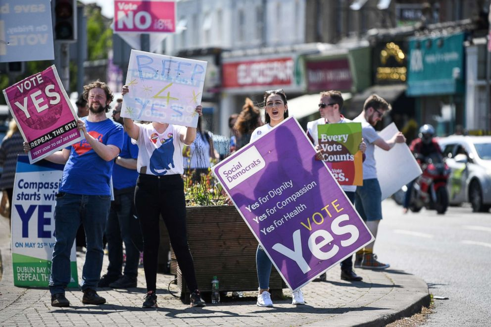PHOTO: People hold yes placards as the country heads to polling stations, May 25, 2018 in Dublin, Ireland. Voters will decide whether or not to abolish the 8th amendment which makes abortions illegal, except when the mothers life is at risk.