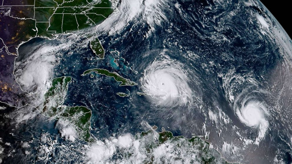 This satellite image obtained from the National Oceanic and Atmospheric Administration (NOAA) shows (L-R) Category 1, Hurricane Katia; Category 5, Hurricane Irma and, Category 1, Hurricane Jose, Sept. 7, 2017.
