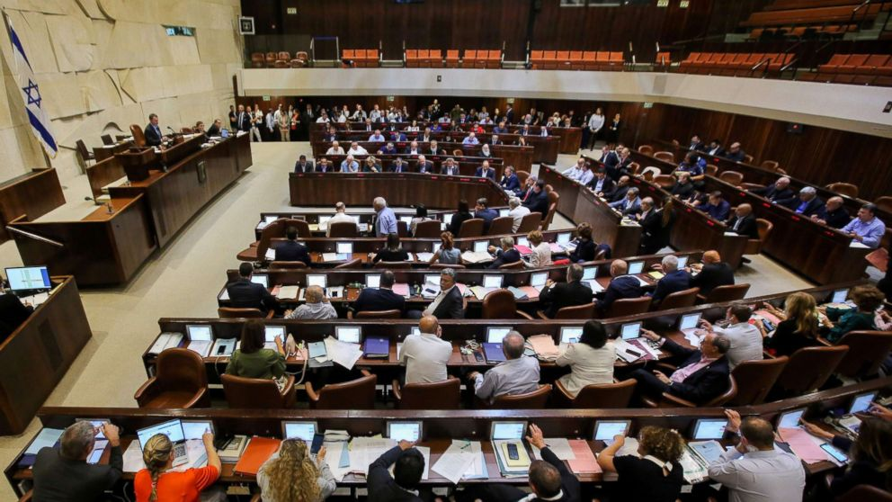 Israeli members of parliament attend the Knesset Plenary Hall session ahead of the vote on a National Law defining the country as the nation state of the Jewish people, July 18, 2018.
