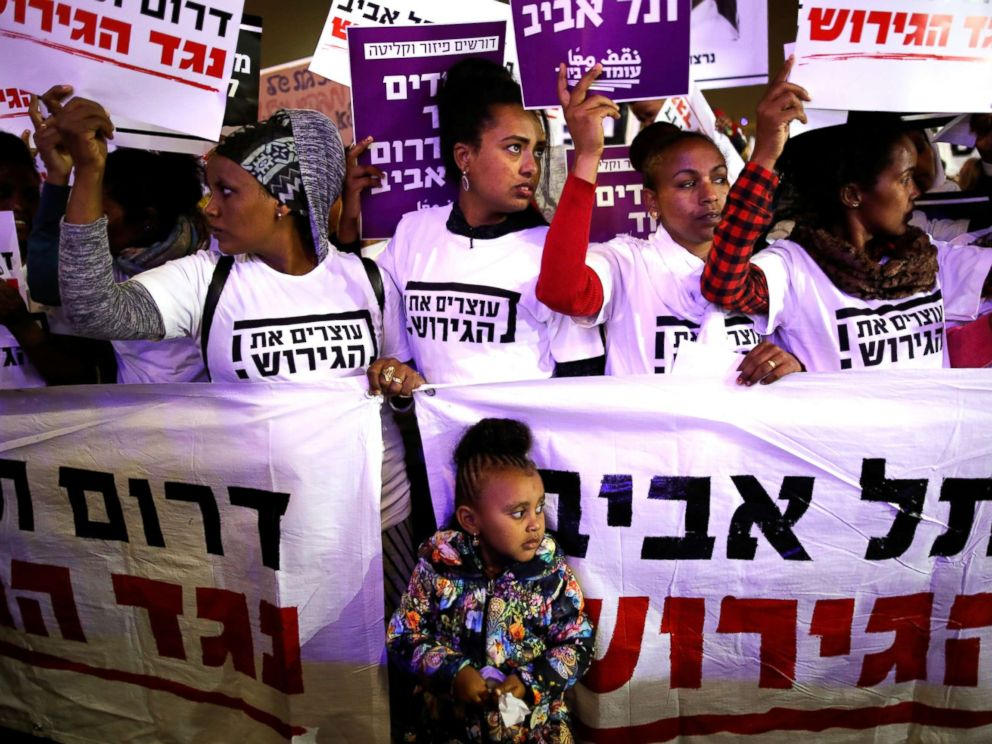 PHOTO: People take part in a protest against the Israeli governments plan to deport African migrants, in Tel Aviv, Israel March 24, 2018.