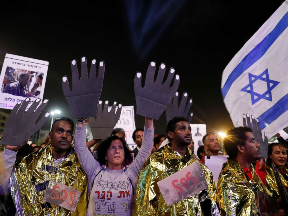 PHOTO: People protest against the deportation of African asylum seekers during a demonstration in Rabin square, Tel Aviv, Israel, March 24, 2018.