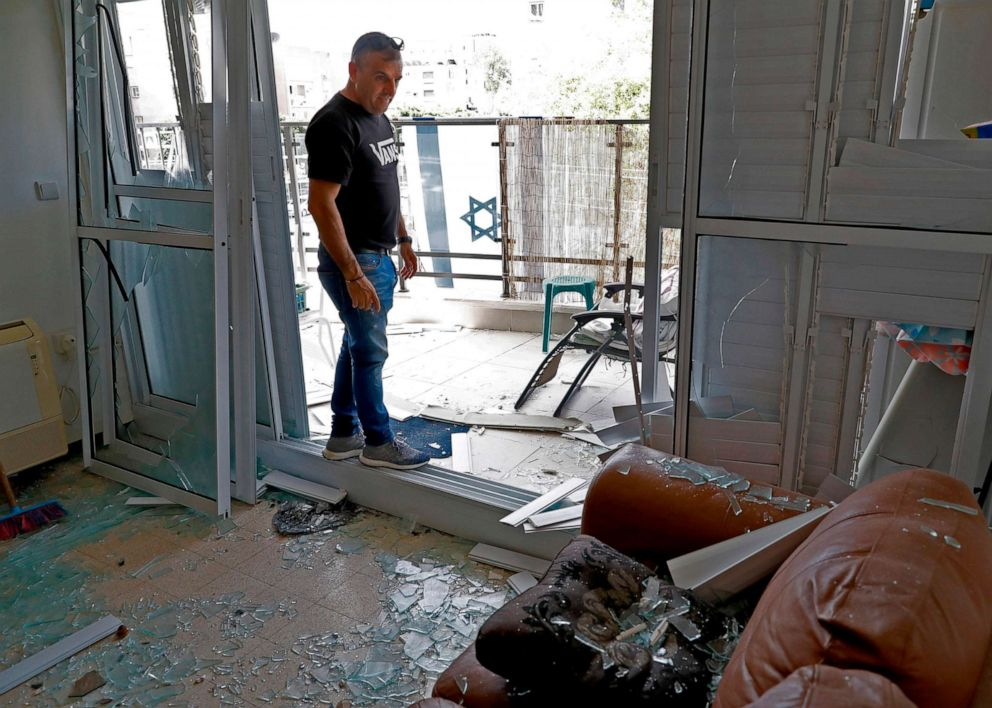 PHOTO: A man looks at the damage inside a building, May 6, 2019, that was hit during a rocket attack from the Gaza Strip on the southern Israeli city of Ashdod, bordering the Palestinian enclave.