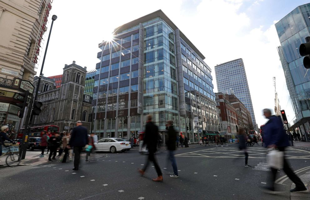 PHOTO: Pedestrians pass the building which houses the offices of Cambridge Analytica in central London, March 21, 2018.