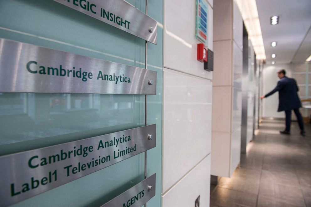 PHOTO: Signs for the company Cambridge Analytica in the lobby of the building in which they are based in London, England, on March 21, 2018.