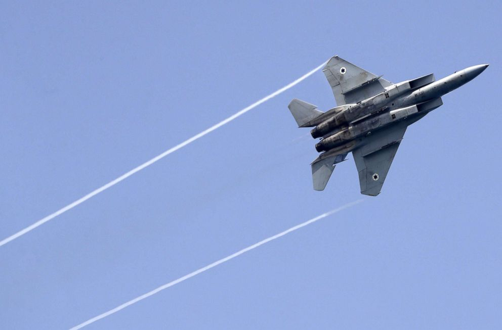 PHOTO: An Israeli F-15 fighter jet performs a rehearsal ahead of an air show to commemorate the 70th anniversary of the creation of Israel in May, in the coastal city of Tel Aviv, April 12, 2018.