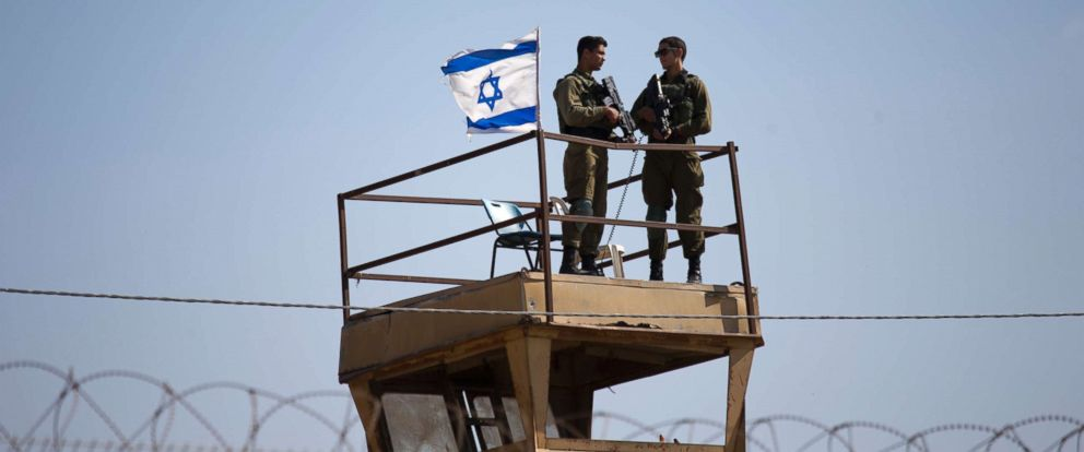 PHOTO: Israeli soldiers guard on top of a watch tower in a community along the Israel- Gaza Strip Border, May 15, 2018.