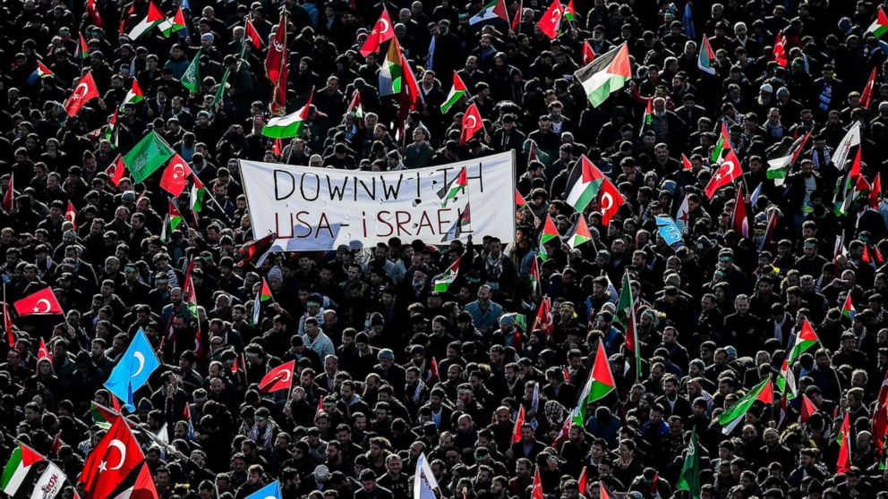 Pro-palestinians protesters chant slogans against U.S. and Israel as they wave Turkish and Palestinians flags, Dec. 10, 2017 during a demonstration in Istanbul.