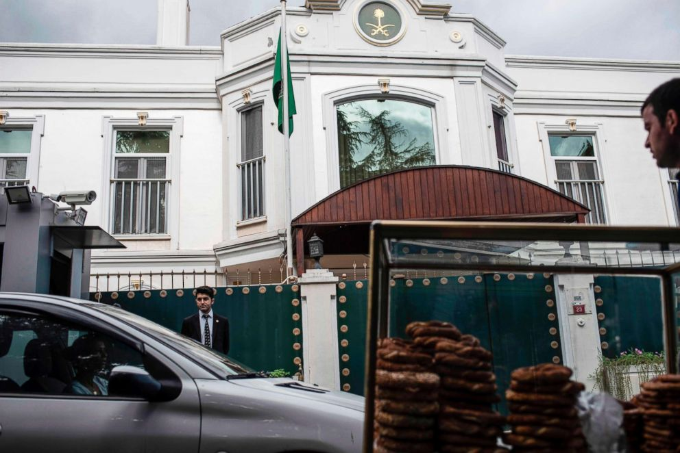 A food vendor pushes his cart past the residence of Saudi Arabia's Consul General Mohammad al-Otaibi in Istanbul on Oct. 16, 2018.