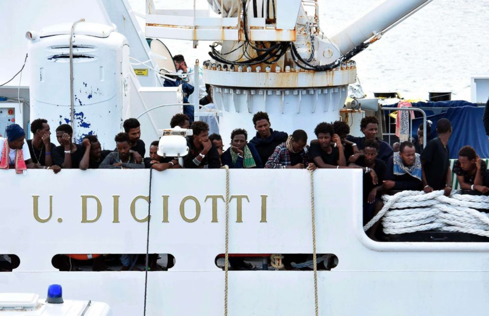 PHOTO: Migrants aboard the Italian Coast Guard ship Diciotti gather on the deck as they await decisions in the port of Catania, Italy, Aug. 24 2018.