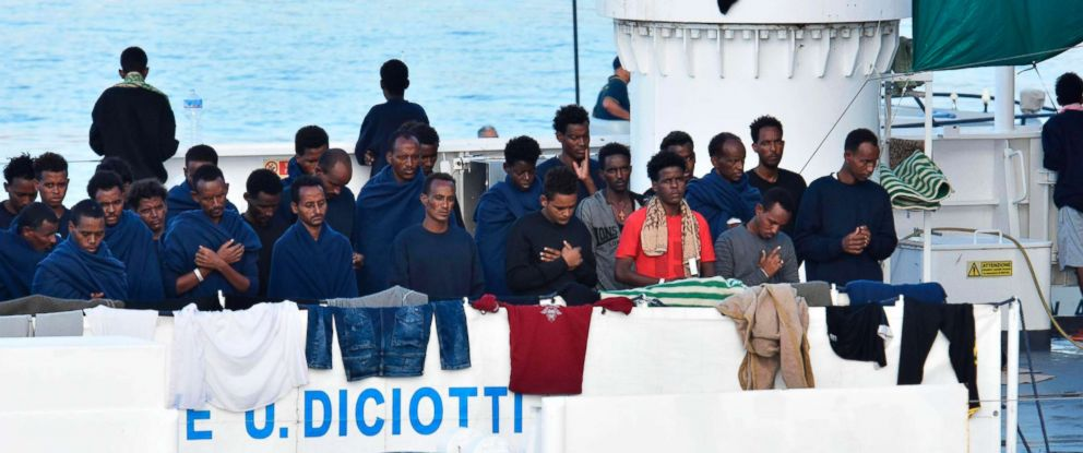 PHOTO: Migrants pray aboard the Italian Coast Guard ship Diciotti moored at port of Catania, Italy, Aug. 22, 2018.