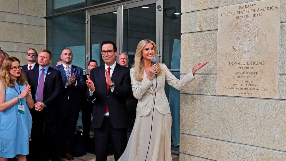 From left, Treasury Secretary Steve Mnuchin claps as White House senior advisor and President Trump's daughter Ivanka Trump unveils an inauguration plaque during the opening of the U.S. embassy in Jerusalem, May 14, 2018.