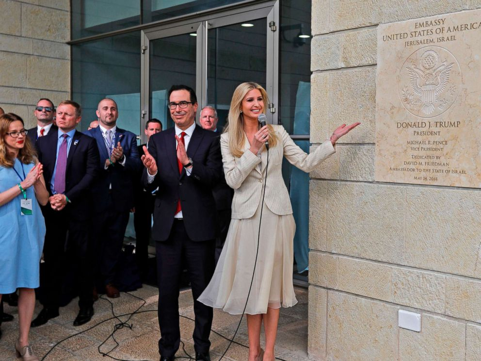 PHOTO: From left, Treasury Secretary Steve Mnuchin claps as White House senior advisor and President Trumps daughter Ivanka Trump unveils an inauguration plaque during the opening of the U.S. embassy in Jerusalem, May 14, 2018.