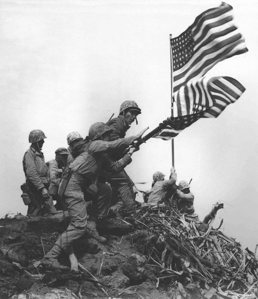 PHOTO: U.S. Marines raise a large American flag to replace a smaller flag first raised at the summit of Mount Suribachi on Iwo Jima, Feb. 23, 1945.