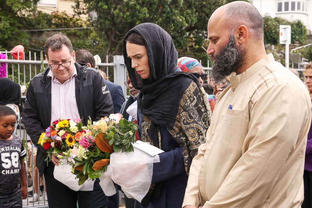 PHOTO: Prime Minister Jacinda Ardern lays flowers for victims of a mass shooting attack while finance minister Grant Robertson looks on at the Kilbirnie Mosque on March 17, 2019 in Wellington, New Zealand.