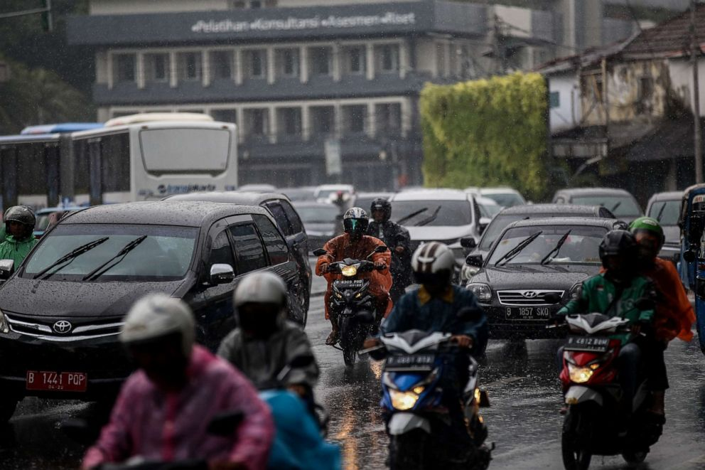 PHOTO: People ride their motorcycle during heavy rainfall in Jakarta, Indonesia on Feb. 22, 2019.