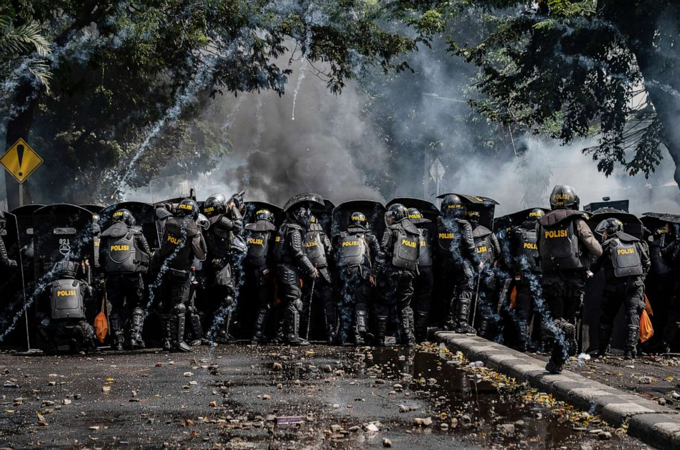 PHOTO: Indonesian riot police clash with protesters during a demonstration after the official government election results were announced, May 22, 2019, in Jakarta, Indonesia.