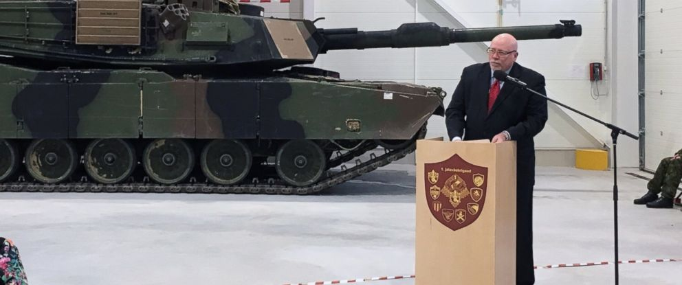 U.S. Ambassador to Estonia James D. Melville Jr. addresses dignitaries in front of an U.S. Army tank, at a hand-over ceremony of the upgraded NATO military base in Tapa, Estonia, Thursday, Dec. 15, 2016.