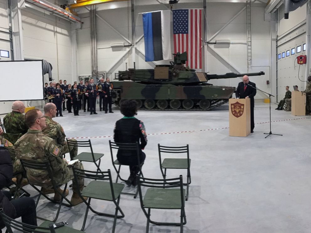 U.S. Ambassador to Estonia James D. Melville Jr. speaks to dignitaries in front of a US Army tank at a delivery ceremony for the upgraded NATO military base in Tapa, Estonia, Thursday, December 15, 2016.