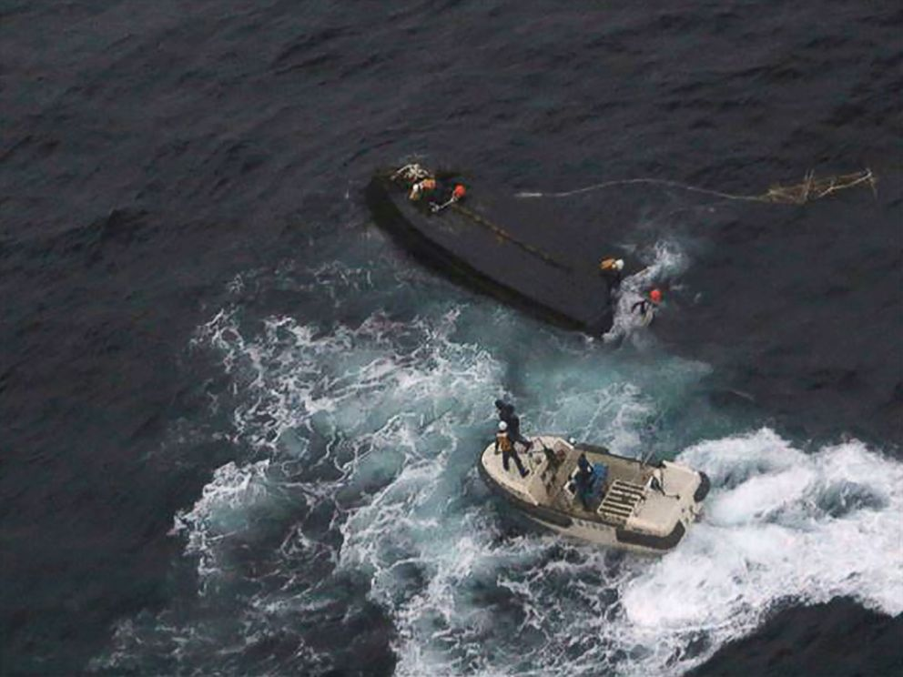 PHOTO: A Japan Coast Guard rescue team approaches a capsized North Korean boat (top) on the Sea of Japan (East Sea), about 225 miles northwest of the Noto Peninsula in Ishikawa Prefecture, Nov. 15, 2017.