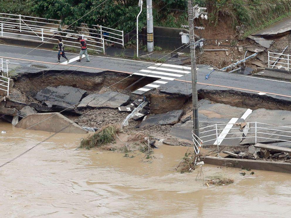 PHOTO: A road is damaged by flood water following heavy rain in Kurashiki city, Okayama prefecture, southwestern Japan, July 8, 2018.