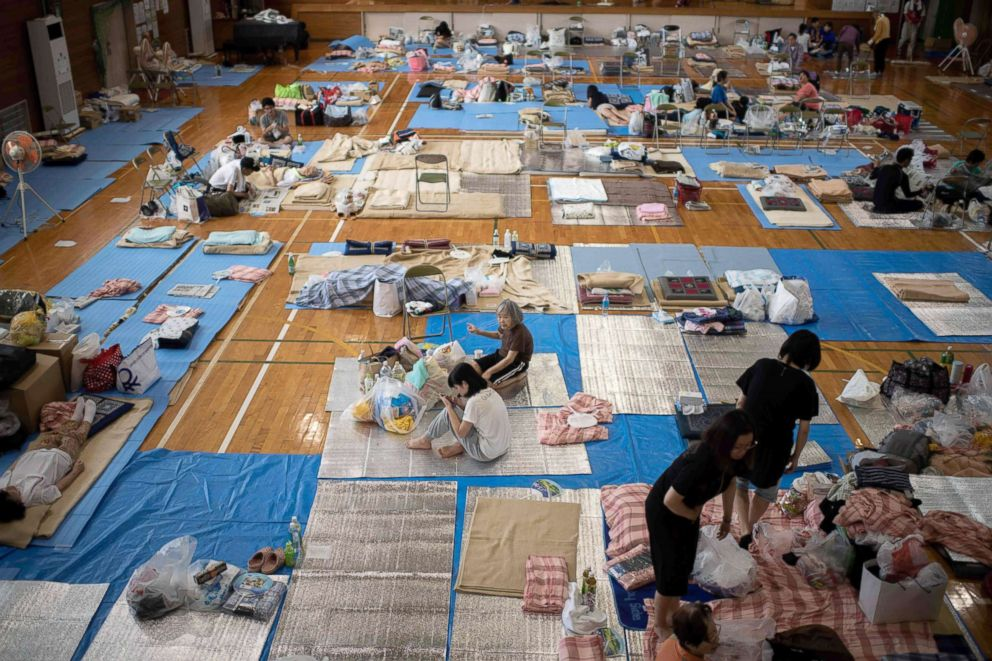PHOTO: People affected by the recent flooding rest at a makeshift shelter in Mabi, Okayama prefecture, Japan, July 11, 2018.