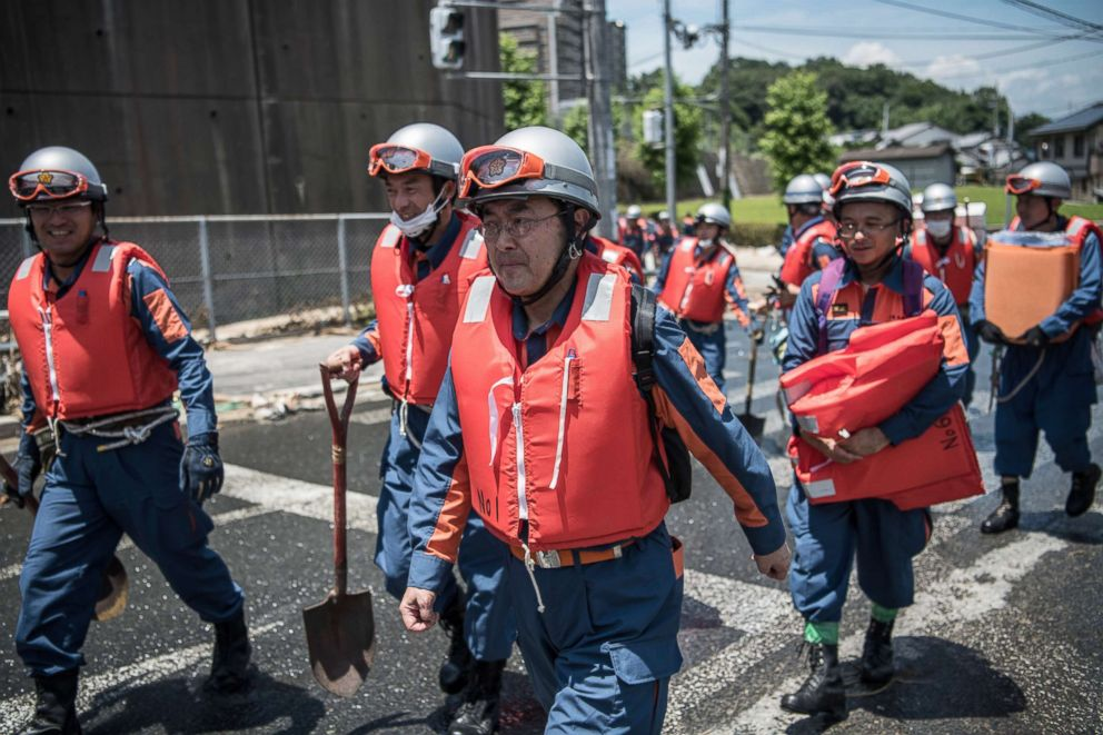 PHOTO: Emergency service workers arrive to search for people following a landslide, July 10, 2018, in Yanohigashi near Hiroshima, Japan.