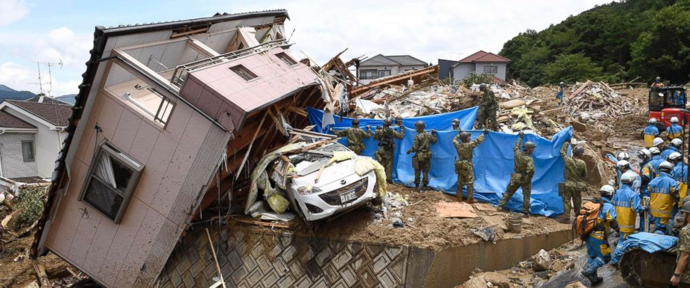 PHOTO: Rescuers conduct a search operation for missing persons in Kumano town, Hiroshima prefecture, western Japan Monday, July 9, 2018.