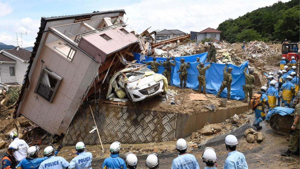 Rescuers conduct a search operation for missing persons in Kumano town, Hiroshima prefecture, western Japan Monday, July 9, 2018.