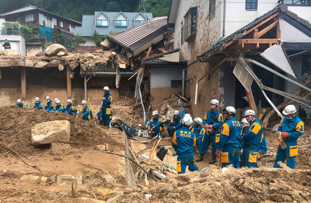 PHOTO: Emergency teams rest outside of structural damage caused by heavy rains, July 9, 2018, in Hiroshima, Japan.