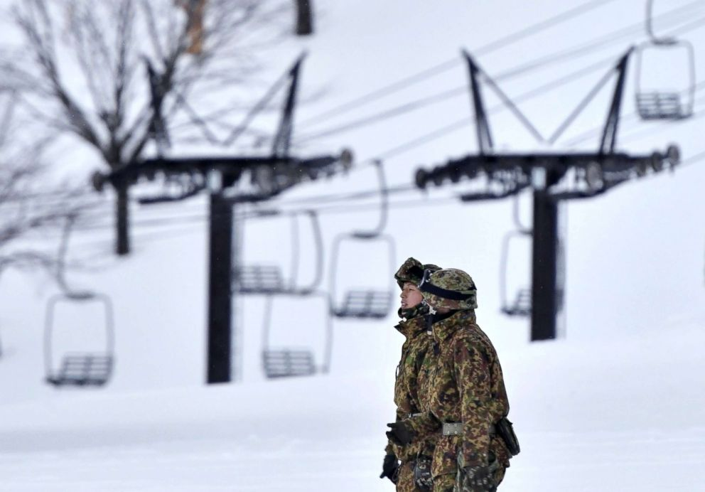PHOTO: Japans Self-Defence Forces members take part in rescue work at a ski resort nearby Kusatsu-Shirane volcano in Kusatsu northwest of Tokyo, Jan. 23, 2018.