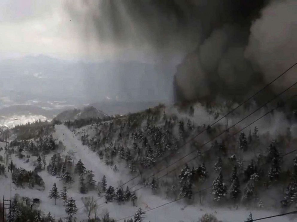 PHOTO: Thick black smoke moves down the snow-covered side of the volcano towards a ski slope after an eruption, in an image from the Kusatsu Mt. Shirane Gondola Unjo camera, Jan. 23, 2018.