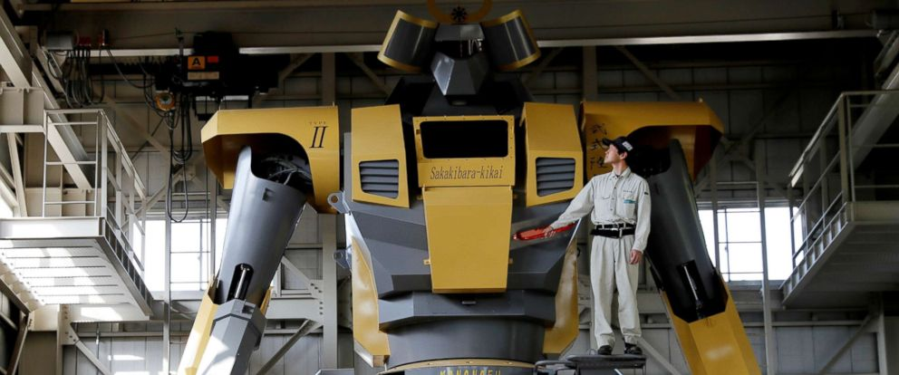 PHOTO: Sakakibara Kikais engineer Go Sakakibara poses with the bipedal robot Mononofu during its demonstration at its factory in Shinto Village, Gunma Prefecture, Japan, April 12, 2018.