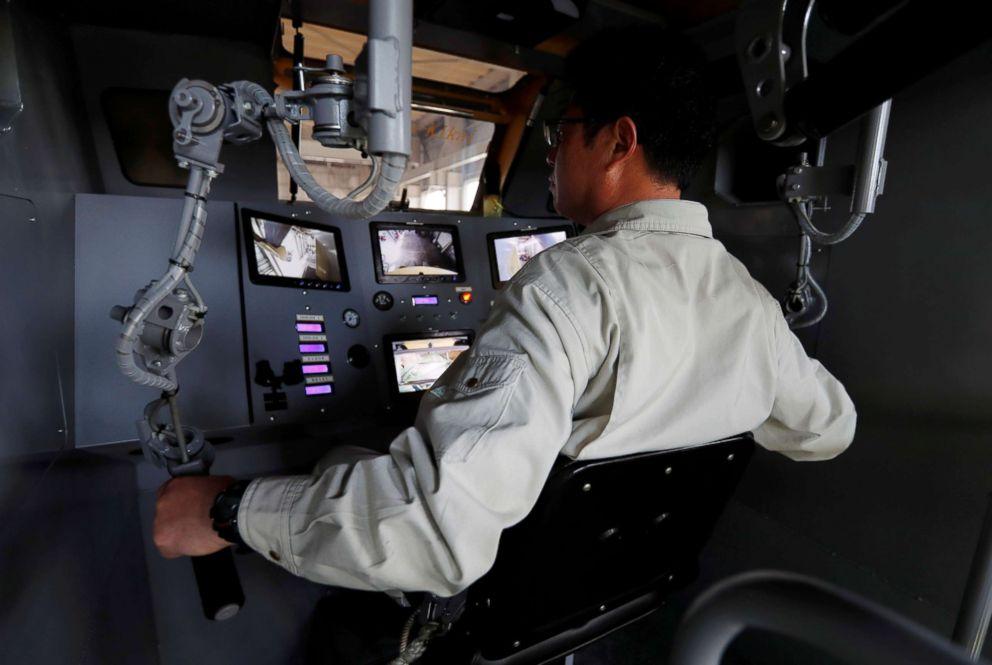 PHOTO: Sakakibara Kikais engineer Masaaki Nagumo controls the bipedal robot Mononofu from its cockpit during its demonstration at its factory in Shinto Village, Gunma Prefecture, Japan, April 12, 2018.