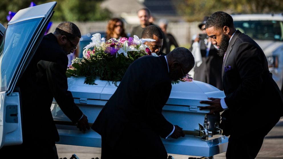 The casket of Jazmine Barnes is removed from the funeral hearse to be taken inside the Community of Faith Church for a memorial service, Jan. 8, 2019, in Houston.