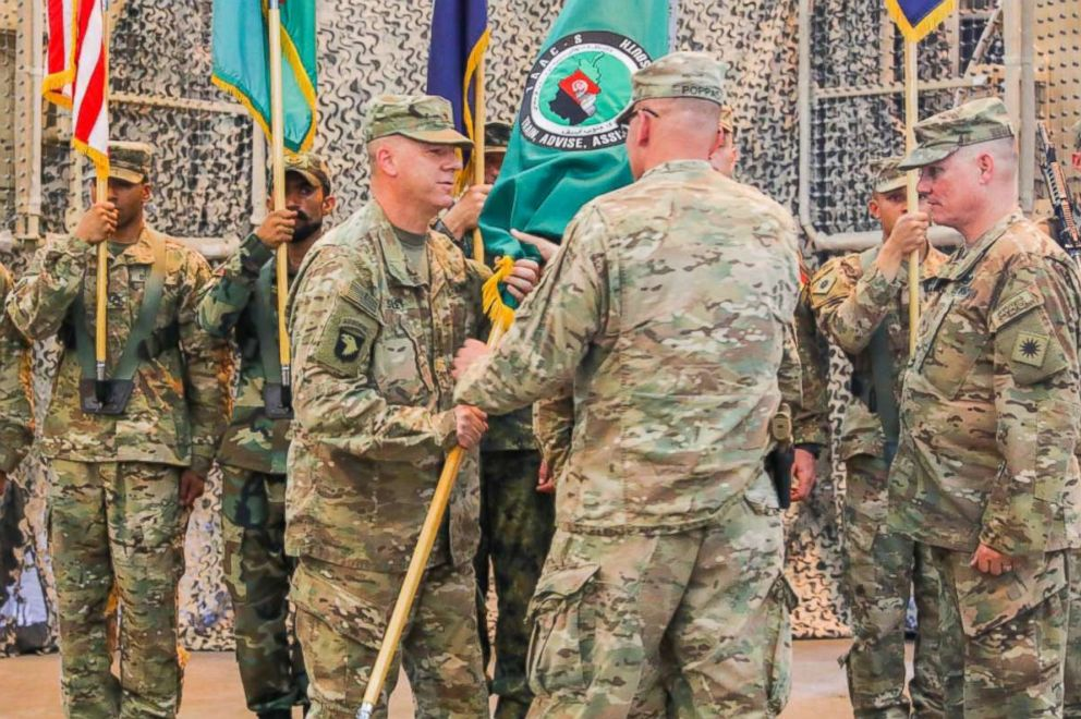 PHOTO: U.S. Army Maj. Gen. Andrew Poppas hands the Train, Advise and Assist Command-South colors to U.S. Army Brig. Gen. Jeffrey Smiley, June 30, 2018 during a Transfer of Authority ceremony in Kandahar, Afghanistan.