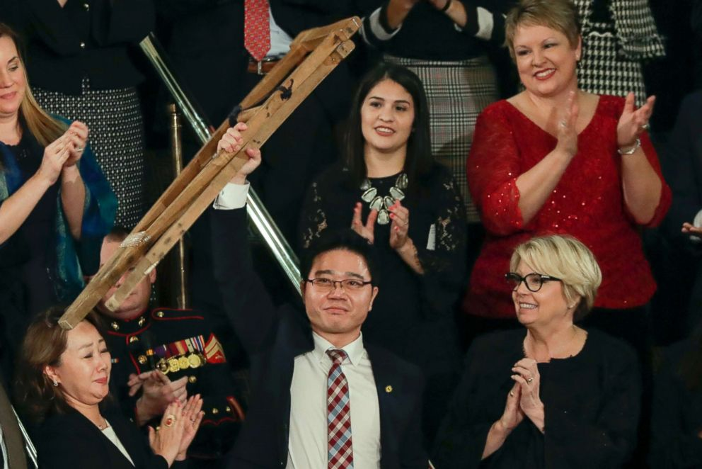 PHOTO: Ji Seong-ho, a North Korean defector, holds up his crutches after his introduction by President Trump during the State of the Union address to a joint session of Congress on Capitol Hill in Washington, Jan. 30, 2018.  For some North Korean defectors, Trump-Kim summit offers hope; others don't buy it ji seong ho file ap jef 180615 hpEmbed 3x2 992