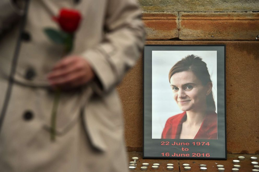 PHOTO: Candles surround a photo of Labour MP Jo Cox before a vigil in her memory as the Leader of Scottish Labour party Kezia Dugdale holds a rose in George Square, June 17, 2016, in Glasgow, Scotland.