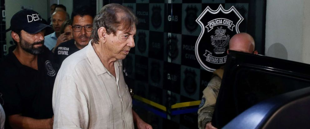 "PHOTO: Brazilian spiritual healer Joao Teixeira de Faria, known as ""John of God"", arrives at the police station a day after being officially ruled a fugitive, in Goiania, Brazil, Dec. 16, 2018."