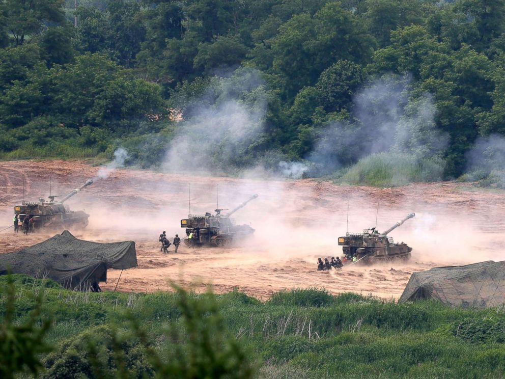 PHOTO: South Korean K-55 self-propelled howitzers artillery participate in a defense exercise at the Mugeon-ri drill field near the Demilitarized Zone (DMZ) in Paju, Gyeonggi-do, South Korea, June 19, 2018.  South Korea calls for 'corresponding measures' from the North after military exercise with US suspended joint us south korea military exercises2 sh mem 180619 hpMain 4x3 992