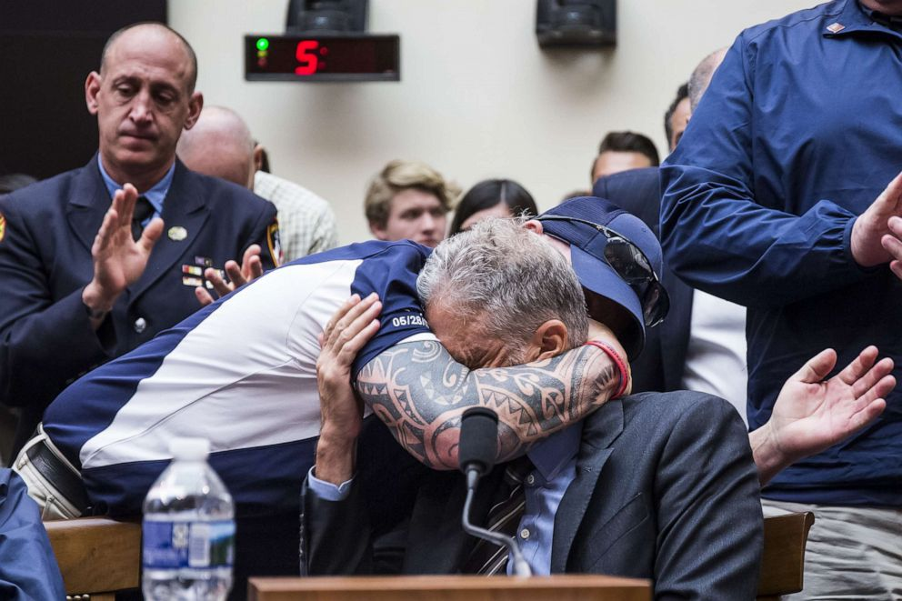 PHOTO: FealGood Foundation co-founder John Feal hugs former Daily Show Host Jon Stewart during a House Judiciary Committee hearing on Capitol Hill, June 11, 2019, in Washington, D.C.