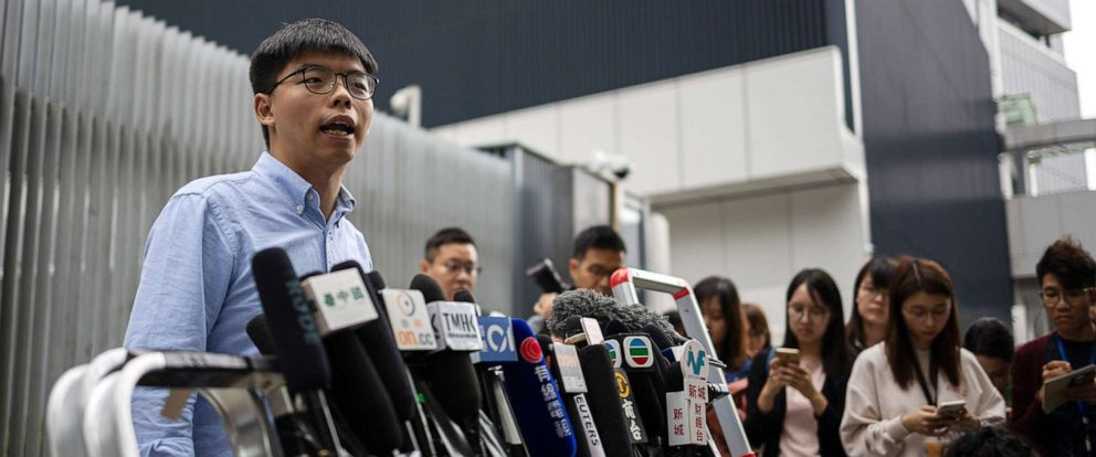 PHOTO: Pro-democracy activist and leader of Hong Kongs Demosisto party, Joshua Wong, left, speaks at a press conference outside the Legislative Council in Hong Kong, Oct. 29, 2019, after he was barred from running in the District Council Elections.