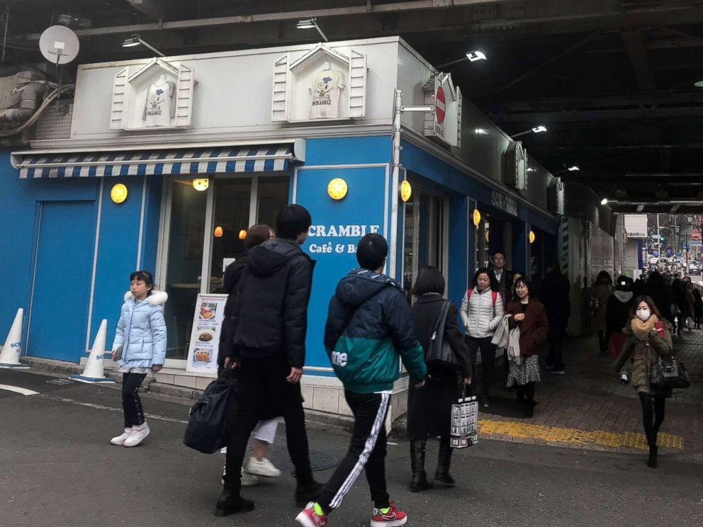 PHOTO: People walk outside the Scramble Cafe & Bar in Tokyo, Jan. 31, 2019.