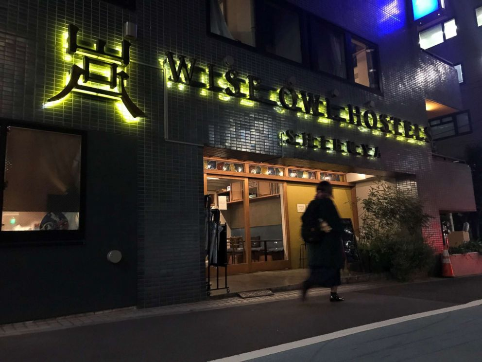 PHOTO: A pedestrian walks past the exterior of Wise Owls Hostels Shibuya in Tokyo, Feb. 1, 2019.