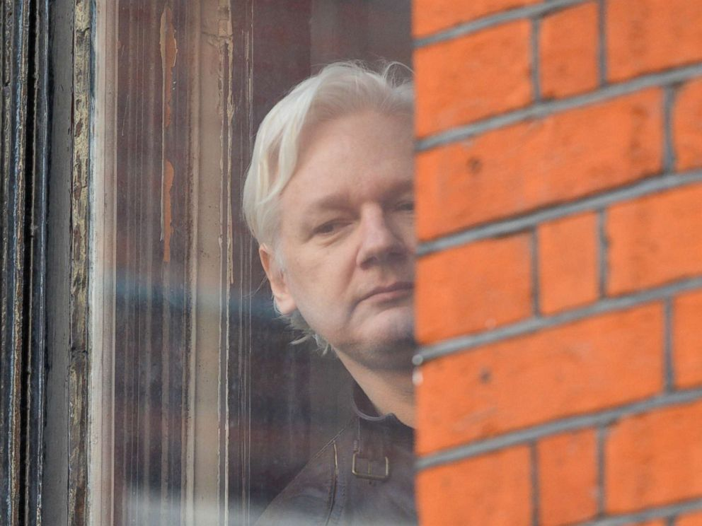 PHOTO: Julian Assange looks out of the window from the balcony of the Embassy Of Ecuador on May 19, 2017 in London.